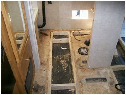 A travel trailer requiring complete floor restructuring, insulation and resurfacing.