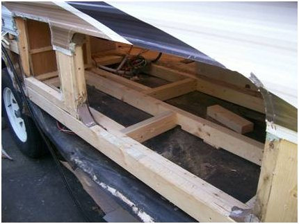 Exterior view of the same travel trailer with the damaged floor removed.