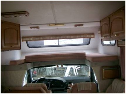Overhead bunk in a class C motorhome completely rebuilt.